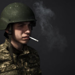 Portrait. A soldier with a cigarette in his mouth