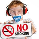 Boy with no-smoking sign.